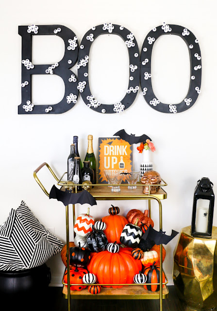 http://blog.consumercrafts.com/seasonal/fall/halloween/eyeball-boo-sign/