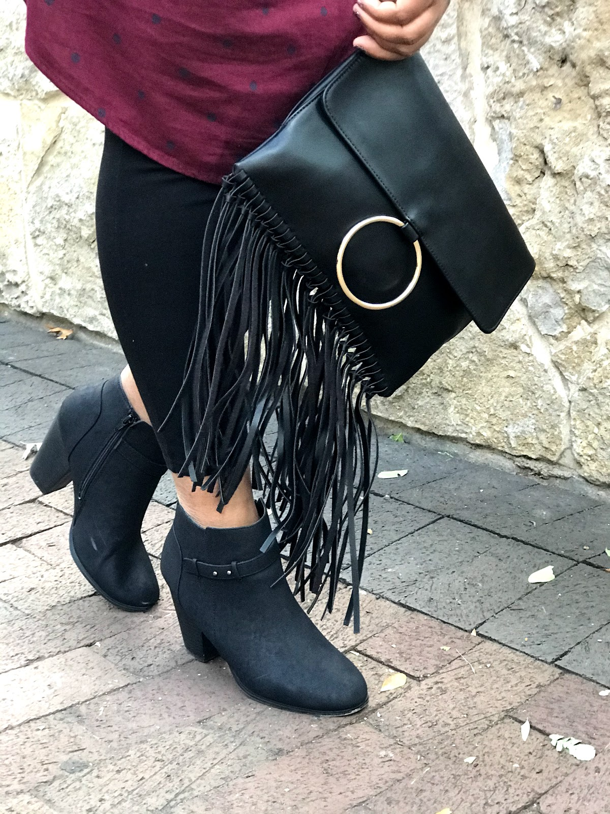Tangie Bell is sharing how she restyled old boots and handbags