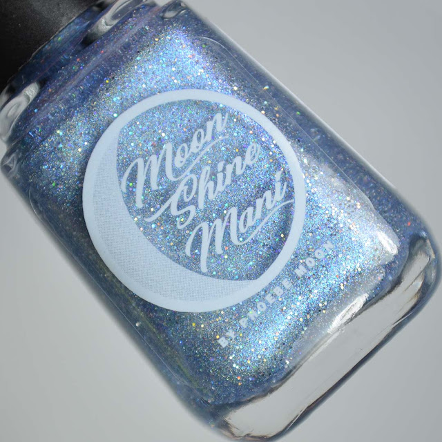 holographic blue nail polish in a bottle