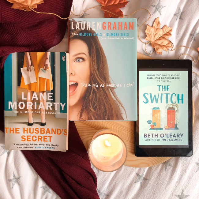 Three books face up on a maroon jumper