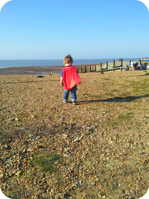 toddler exploring, whitstable beach, toddler pebbles