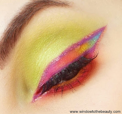 green with rainbow eyeliner makeup