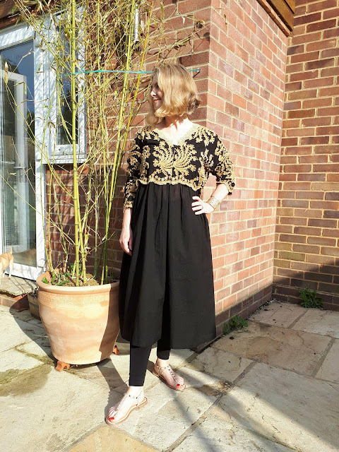 image showing eva trends black midi dress styled