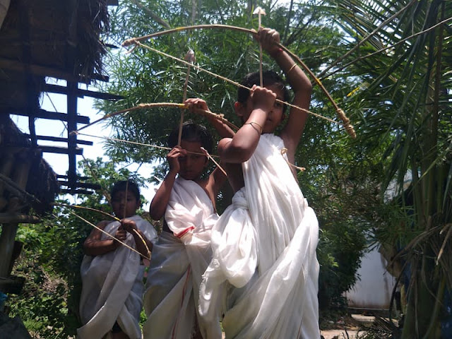 Children Playing Ramayana in India with Bamboo Bows