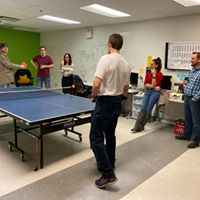 Venn Garage pitching business idea while playing ping pong.