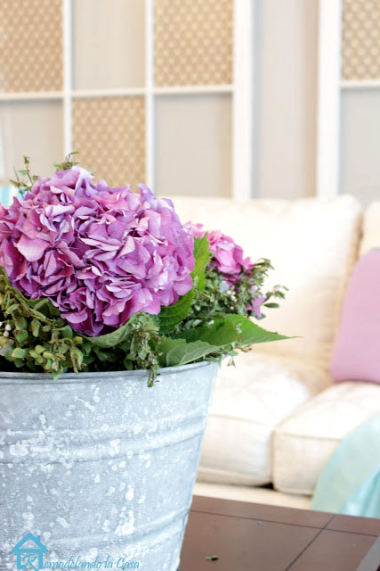 arrangement of hydrangeas in rusted bucket