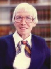 photo of older white woman with white hair and glasses