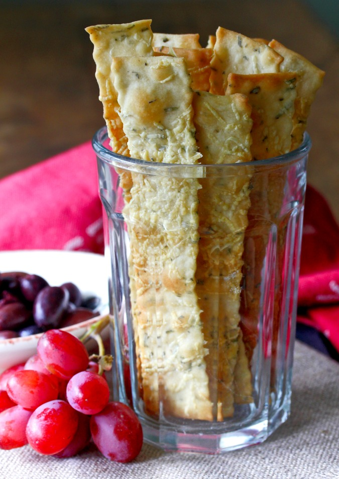 Rosemary Parmesan Crackers are so thin and crispy, and full of flavor. They are perfect for hostess gifts during the holidays, if you can bring yourself to give them away.