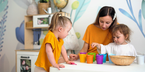 Stock photo of teacher working with young children