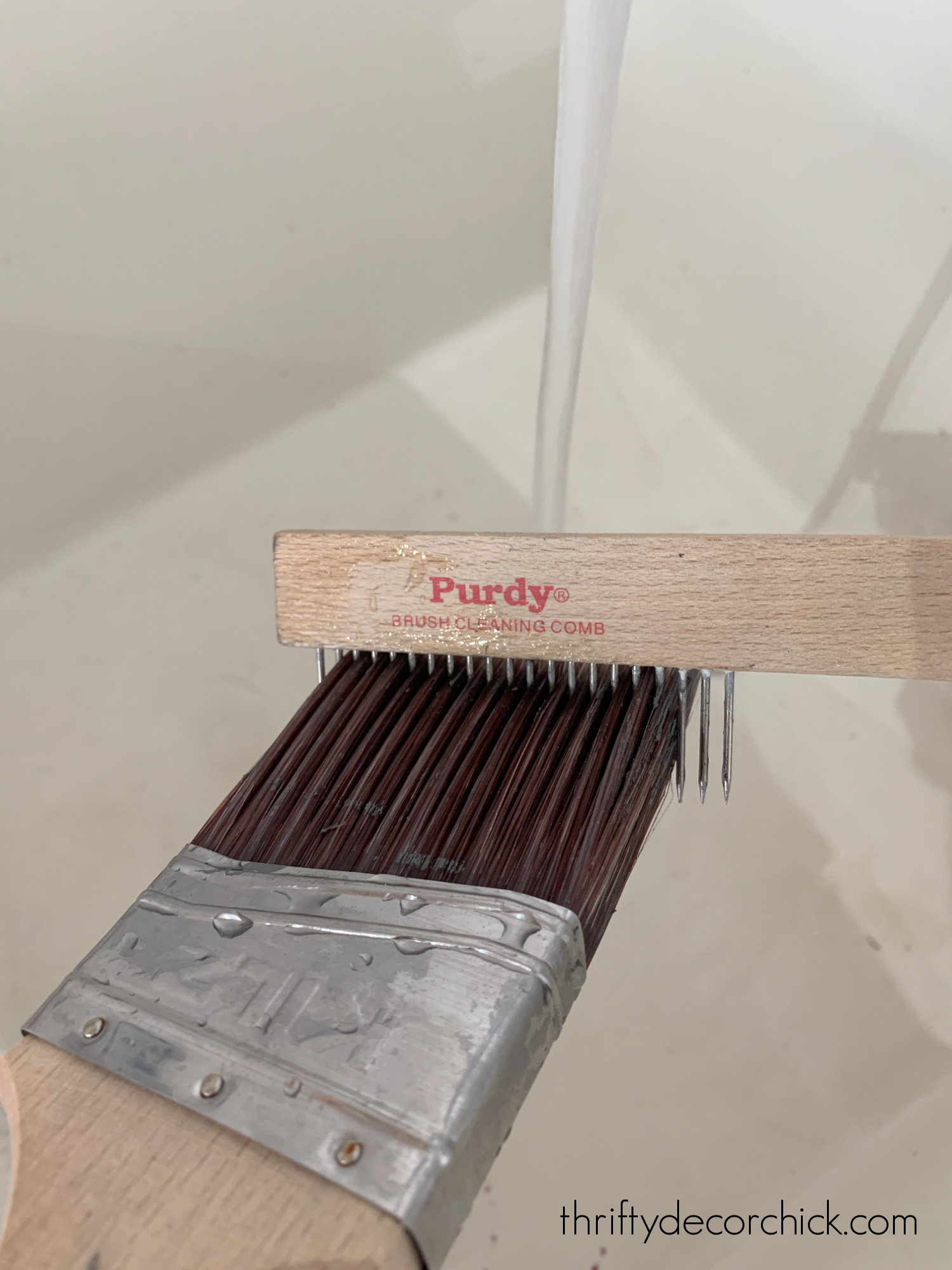 paint brush cleaning comb