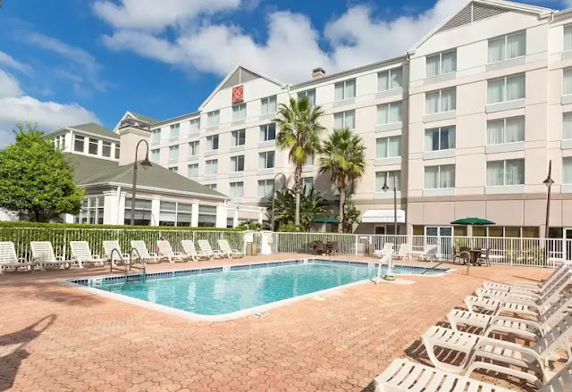 Stay at Hilton Garden Inn Hotel Daytona Beach Airport, FL, located across from Daytona Speedway, offering 24-hour free shuttle service and WiFi.