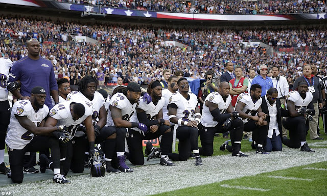 NFL players drop to their knees during national Anthem in protest against Trump