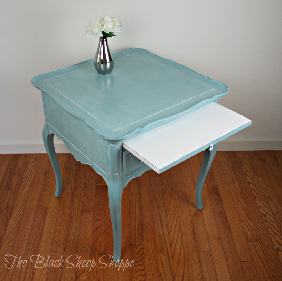 The table is painted in Provence blue. The sliding tray is pure white.