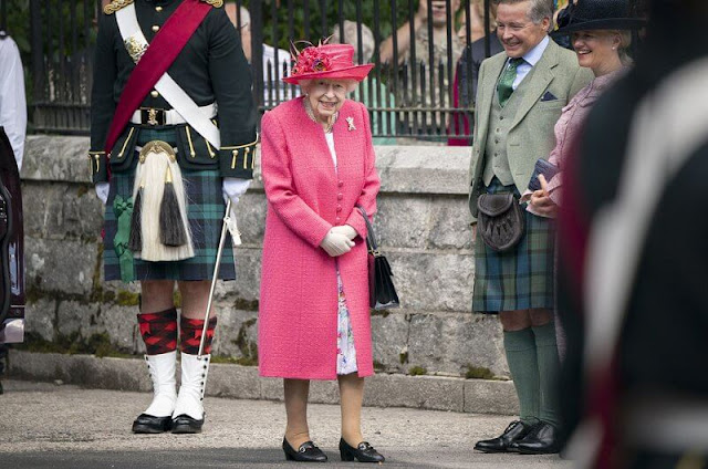 The Queen wore a raspberry pink coat and a matching hat, with a floral dress