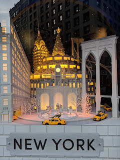 Animated display featuring yellow taxis and New York landmarks, Lord & Taylor, Fifth Avenue, New York, New York