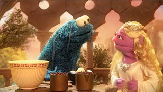"""Cookie Monster plays """"Gobble,"""" who must stay patient as he tries to remember the recipe for the """"one dessert to rule them all."""" Sesame Street Cookie's Crumby Pictures The Lord of the Crumbs."""