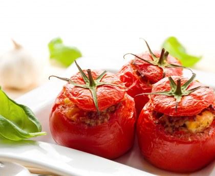 Stuffed tomatoes with basil sauce