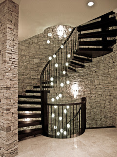 classic metal staircase with spiral structure and pendant stair lights