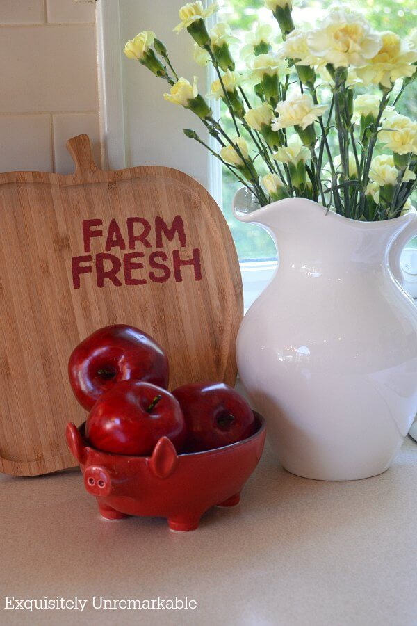 Thrift Store Cutting Board that says farm fresh next to apples and flowers