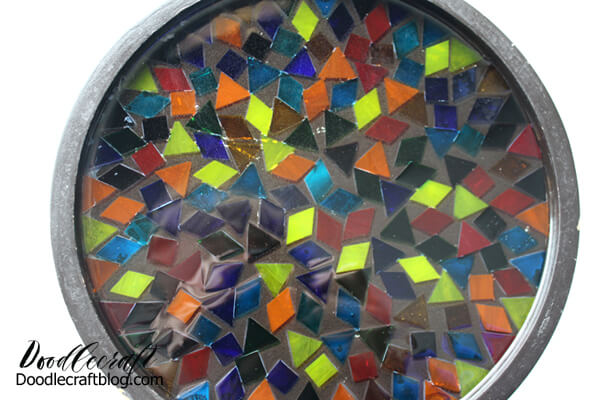 Design the mosaic however you like. Will you decorate it randomly or take the time to lay the pieces in an orderly pattern?