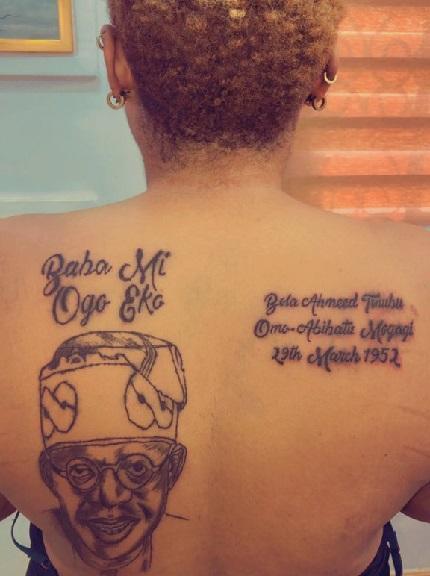 Photo: Woman tattoos Bola Tinubu on her back