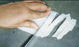 Cutting fish fillet into finger sized for fish fingers recipe