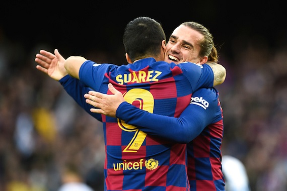 Luis Suarez and Antoine Griezman of Barcelona embrace