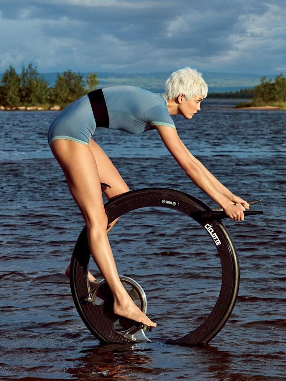 Karlie Kloss aboard a futuristic monowheel contraption - Patrick Demarchelier for Vogue, December 2014