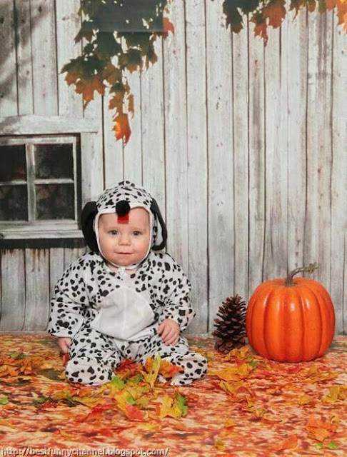 Funny baby in dalmatian costume.