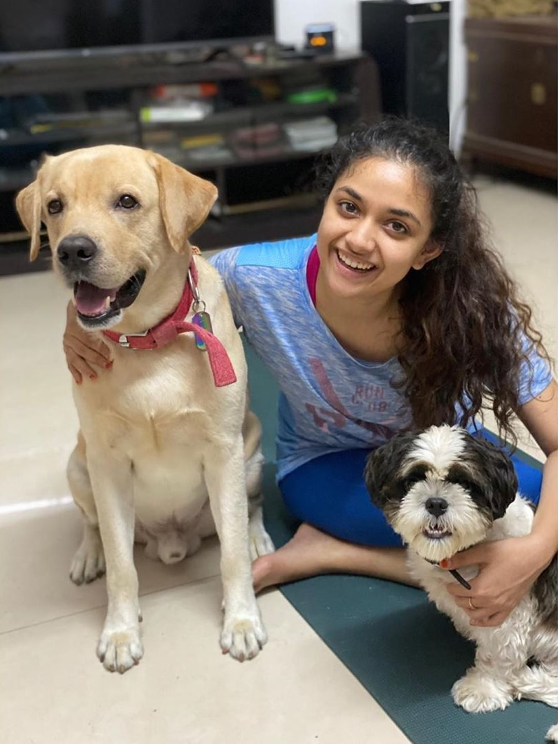 Keerthy Suresh with Lovely Smile along with her Lovely Cute Pet Dogs