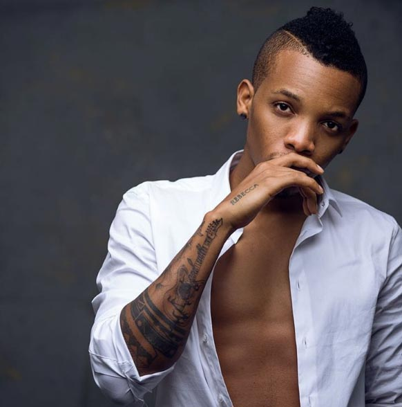 Tekno shares new photos as singer debuts new look