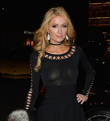 Paris Hilton stepped out in a see-through outfit as she left a ...