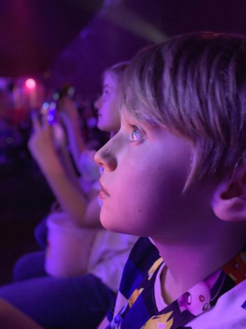 Boy watches circus act at Zippos