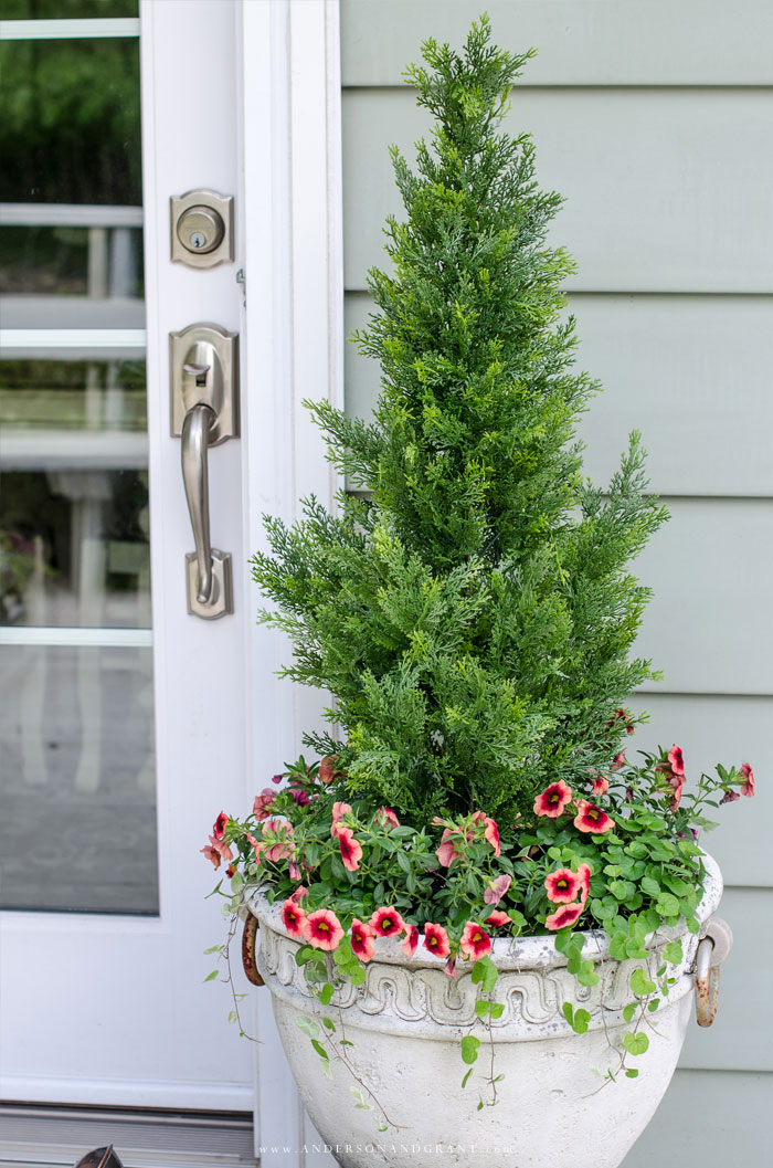 These shrubs in a planter add instant curb appeal without the maintenance. #frontporch #porch #curbappeal #andersonandgrant