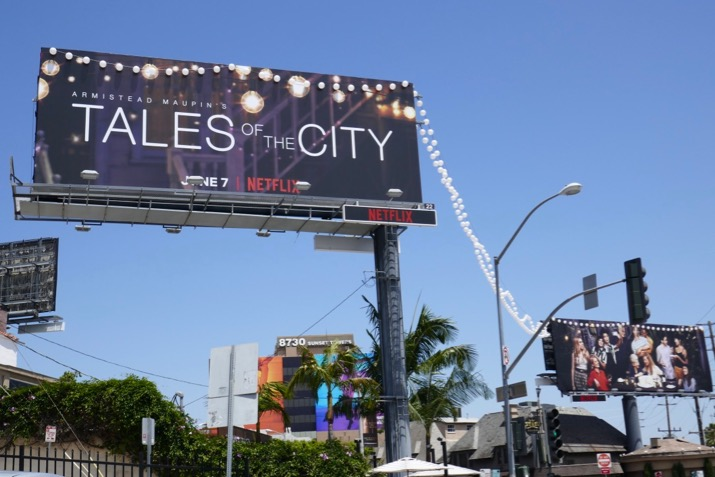Tales of the City string lantern lights billboards