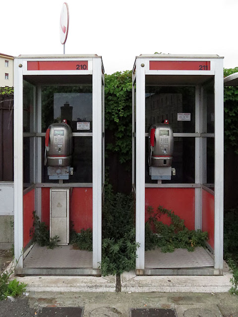 Phone booths and weeds, Piazza dell'Arsenale, Livorno