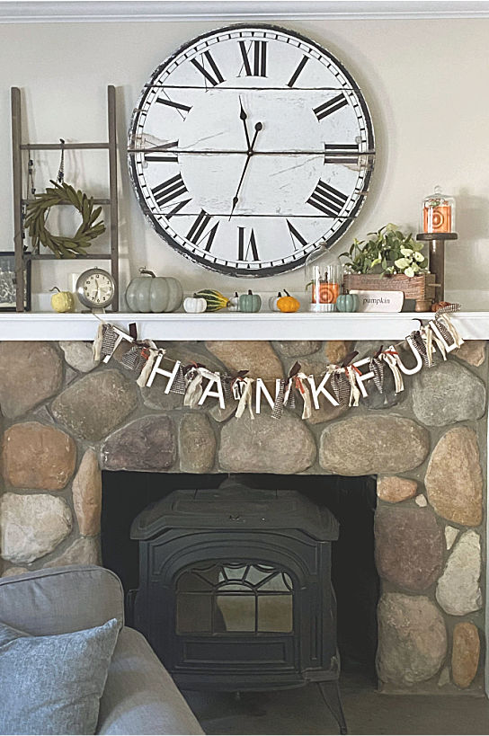 thanksgiving mantel with thankful banner