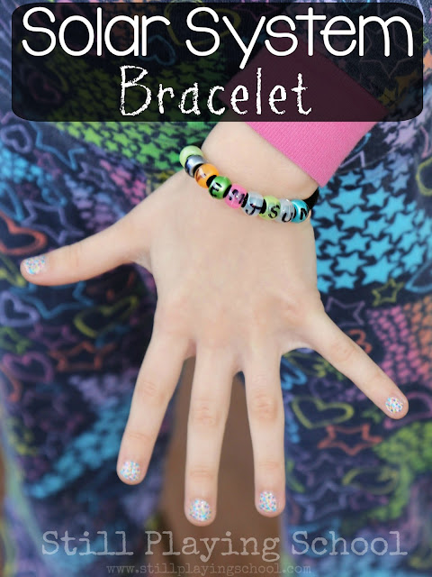 Help kids learn the order of the planets in our solar system with this fun outer space bracelet craft!
