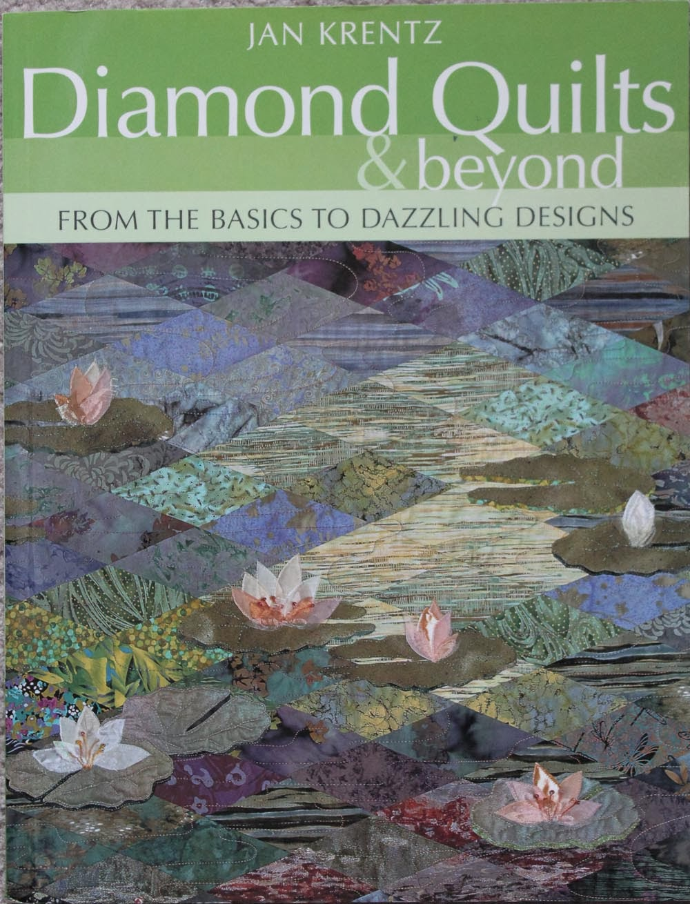 http://www.amazon.com/Diamond-Quilts-Beyond-Dazzling-Designs/dp/1571202404/ref=as_li_qf_sp_asin_til?tag=quiltfab-20&linkCode=w00&creativeASIN=1571202404