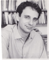 "photograph of James Gleick taken before 1992 for his book ""Genius"" about Richard P. Feynman shows a man about 40 with medium length curly back hair."