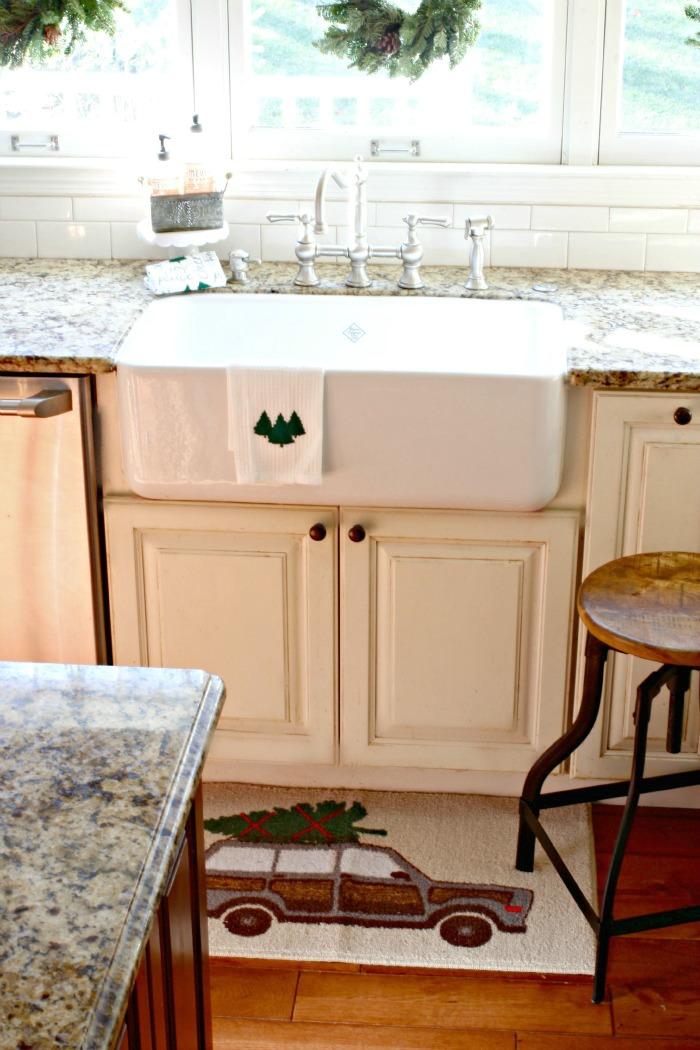 Shaw's farm sink with Target kitchen rug - Christmas kitchen ideas - www.goldenboysandme.com