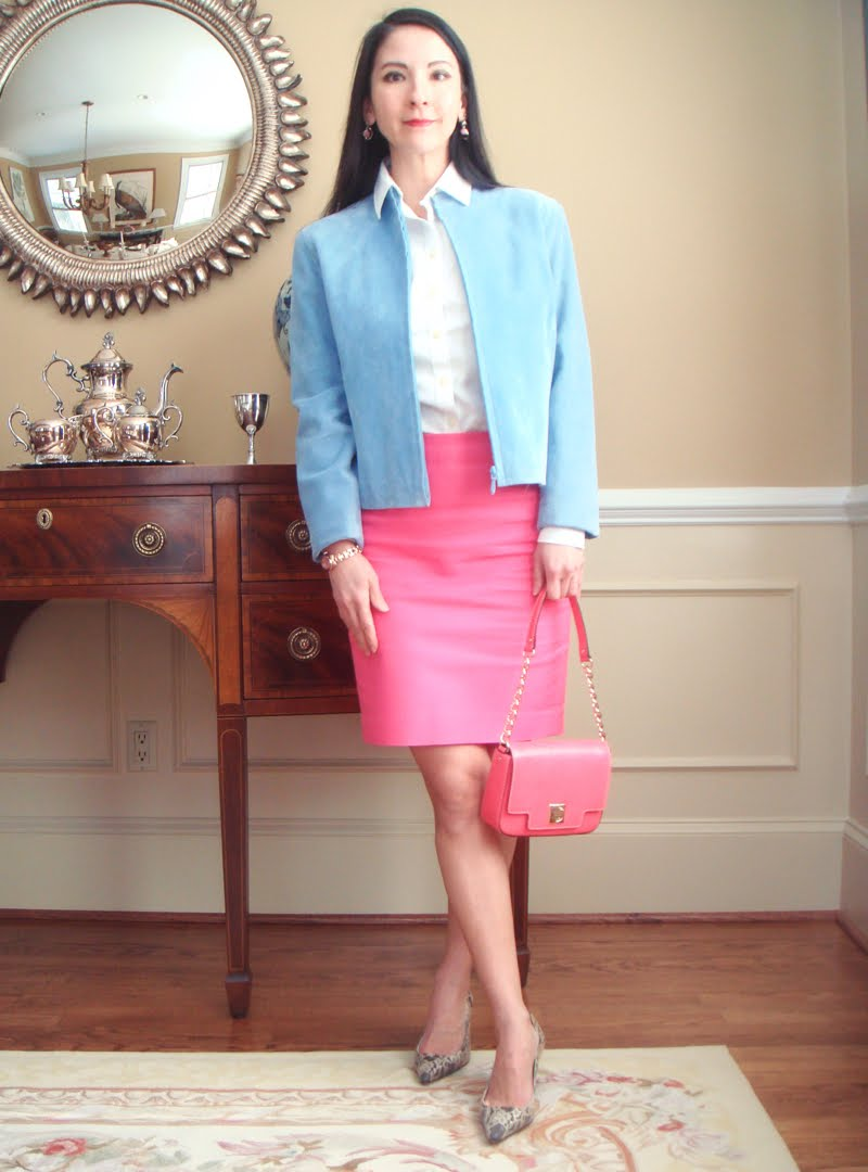 Bright Pink Work Outfit - holding bright pink small bag with gold chain and wearing lace closed toe heels.