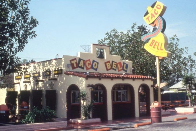 Glen Bell daily watched the long lines of customers at the Mexican restaurant, located directly across from the booth where hot dogs were sold.