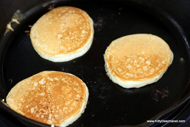 cooking pancakes on a cast iron pan