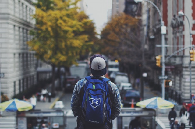 travelling alone, guy with a backpack