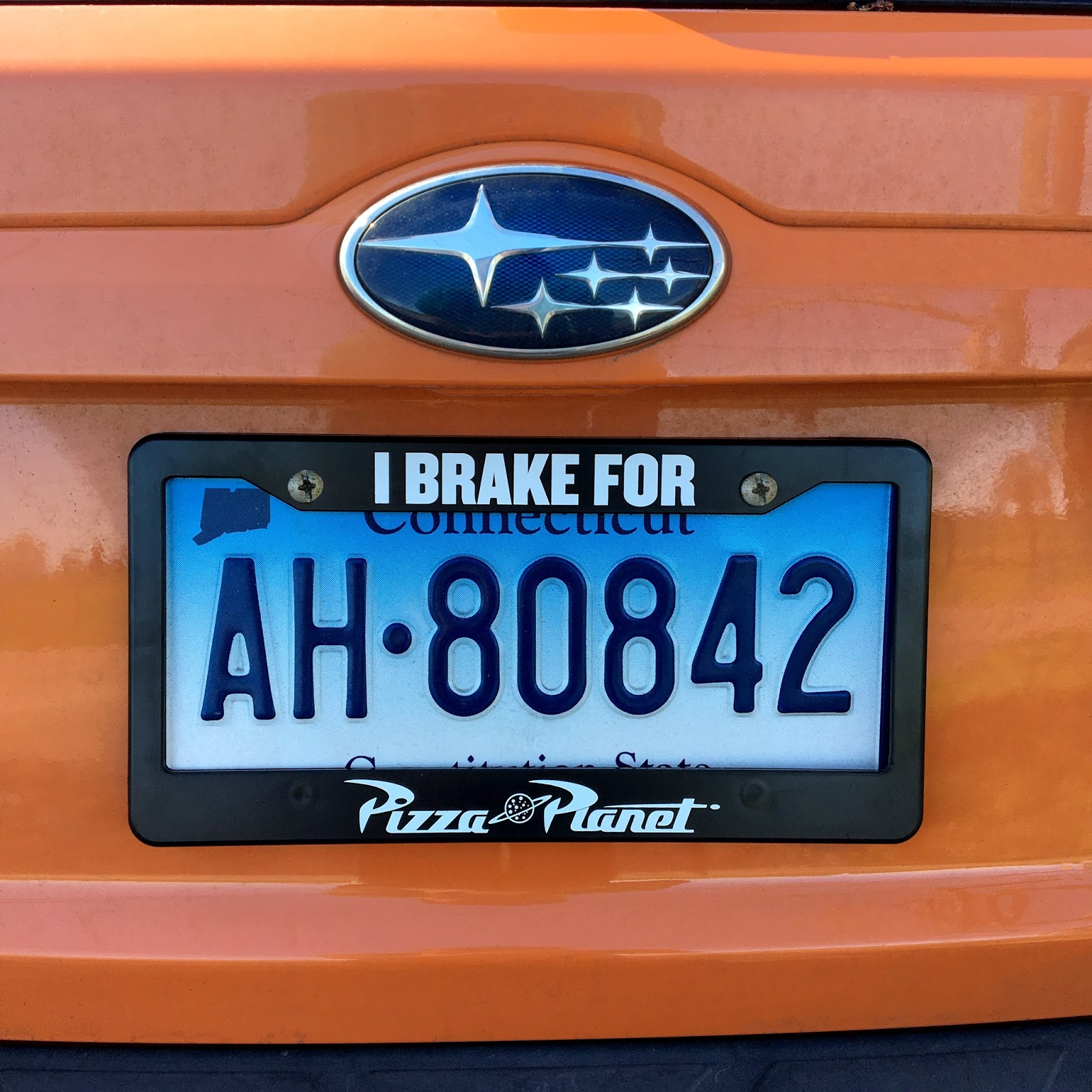 disney pixar pizza planet license plate frame cover
