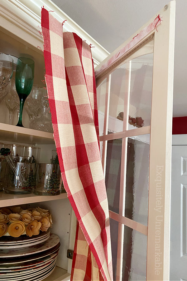 Flopping Cabinet Fabric on a glass cabinet door