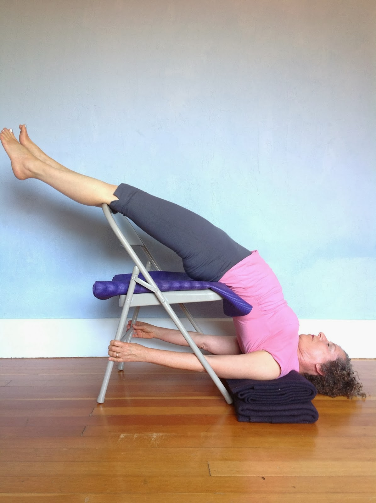 hanging yoga chair home depot legs featured pose shoulderstand