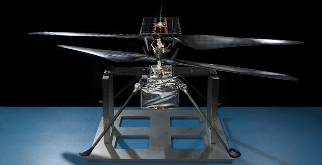 This image of the flight model of NASA's Mars Helicopter was taken on Feb. 14, 2019, in a cleanroom at NASA's Jet Propulsion Laboratory in Pasadena, California. The aluminum base plate, side posts, and crossbeam around the helicopter protect the helicopter's landing legs and the attachment points that will hold it to the belly of the Mars 2020 rover. Image Credit: NASA/JPL-Caltech