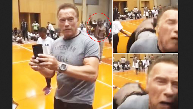Arnold Schwarzenegger gets a hard kick to his back